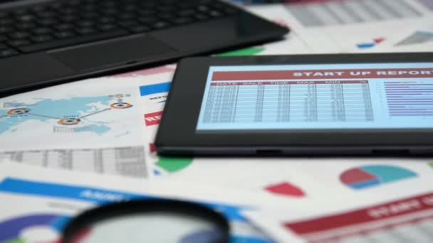 Accountants Workplace With Business Report On Screen Touch Pad And Other Items.