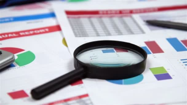 Office Desktop With Business Items, Stock Exchange Statistics, Magnifying Glass, Pen And Financial Report