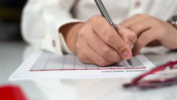 Accountant Man Fills Annual Report And Financial Statistics. Paperwork Concept
