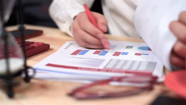 Businessman Monitoring Stock Statistics And  Financial Report. Close Up