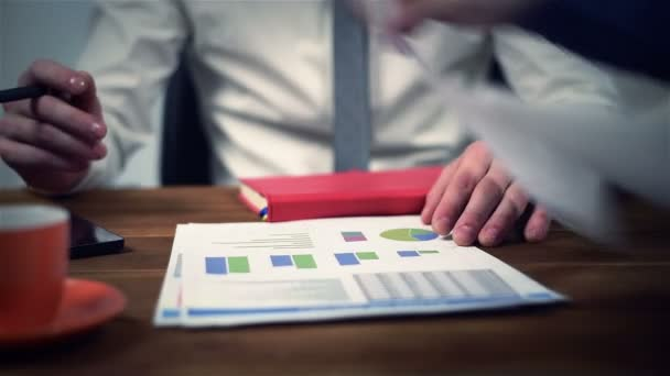 Two Businesspeople Checking Financial Report And Analyzing Report