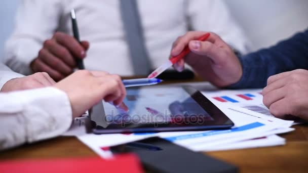 Businesspeople Using Digital Tablet Pc With Stock Exchange Statistics.