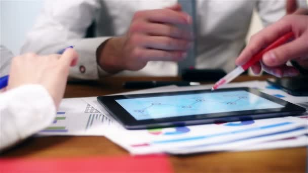 Co Worker Using Tablet With Stock Exchange Statistics. Paperwork Concept. Slow Motion Effect