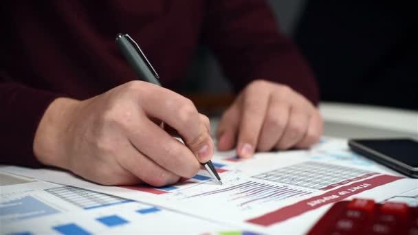 Businessman Monitoring Stock Statistics. Close Up