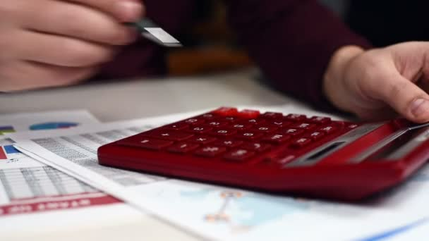 Trader Hand Using Red Calculator. Business Concept. Close Up