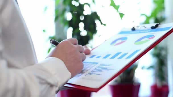 Businessman Analyzing Investment Charts And Stock Statistics. Paperwork Concept