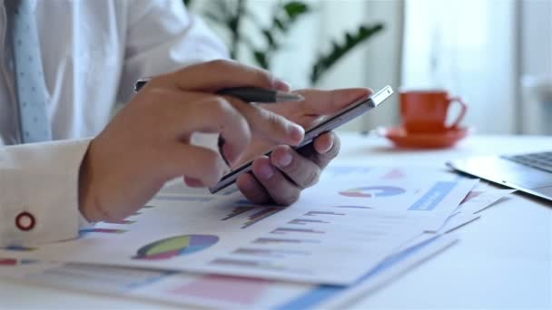 Trader Analyzing Income Charts And Graphs On Smartphone Screen. Business Concept