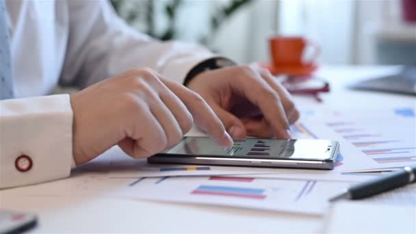 Businessman Using Mobile Phone With Growth Graph Chart And Stacks Data,