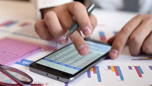 Trader Using Mobile Phone With Graphs And Charts On Screen