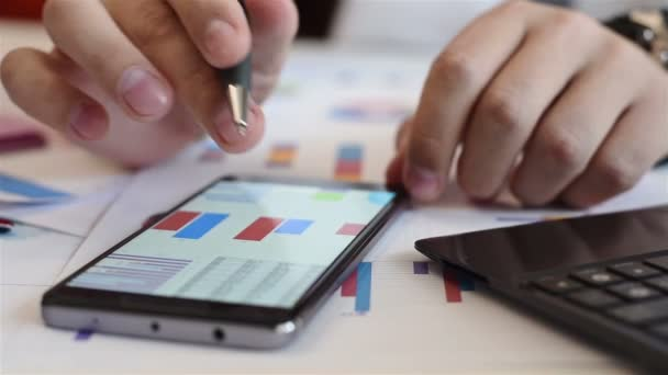 Trader Analyzing Income Charts And Graphs On  Mobile Phone Screen. Business Concept