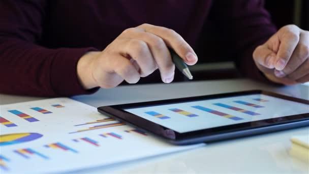 Businessman Checks Financial Data