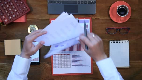 Businessman Checks Investment Charts And Stock Statistics On Clipboard. View From Above