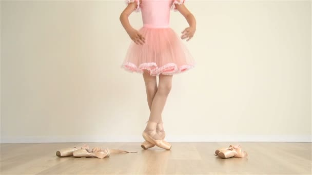 Young Ballerina In Pink Dress Doing Workout In Classroom