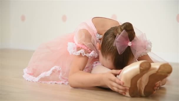 Little Ballerina In Pointe Shoes Does Stretching. Close Up