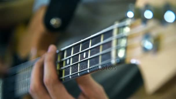 Musician Playing On Bass Guitars. Close Up