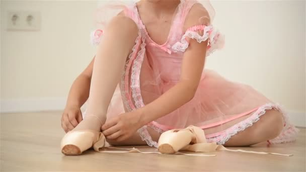 Little Ballerina In Pink Dress And Pointe Shoes Is Dancing In Room