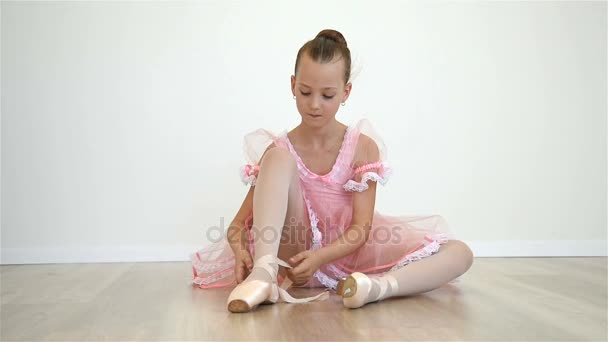 Little Ballerina In Pink Dress And Pointe Shoes Is Dancing In Room.