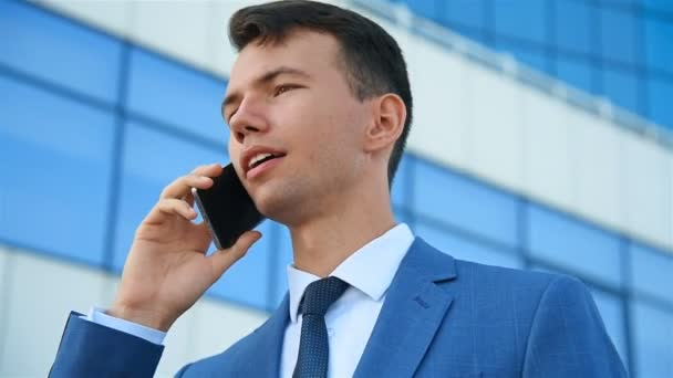European Businessman In Suit  Talking On  Mobile Phone.
