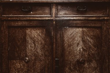 Vintage wardrobe close up. Retro furniture. The background texture rough distressed wood