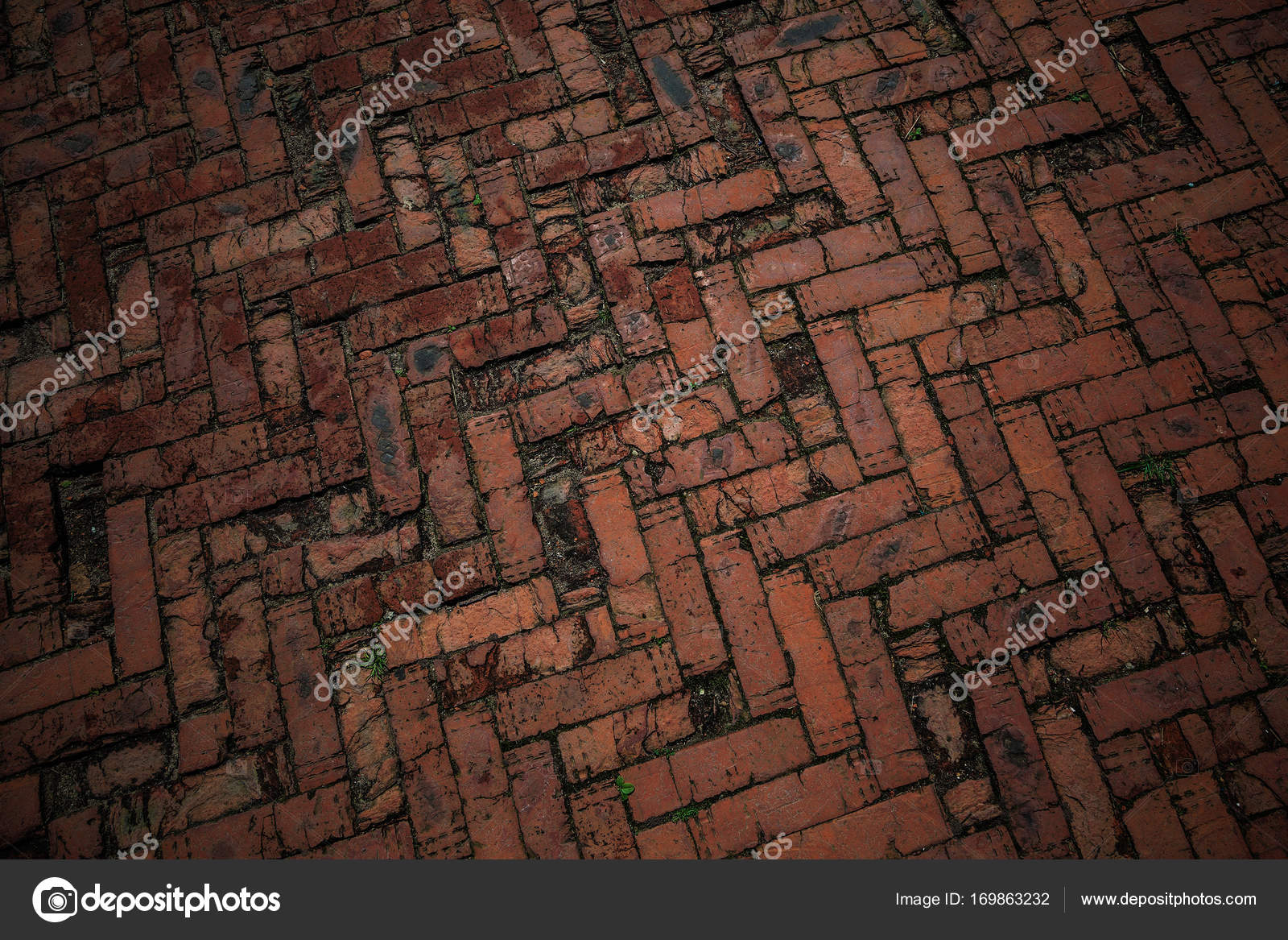 De weg is geplaveid met rode bakstenen achtergrond textuur van