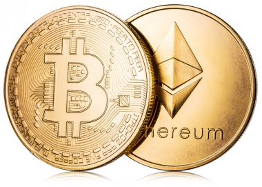 Physical bitcoin and ethereum coin on white background. Blockcha