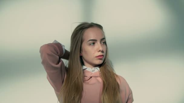 Stylish Girl Posing Before Wall