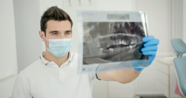 Dentist Examining X-ray Scan