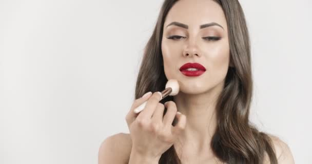 Brunette Woman With Makeup Brush Closeup