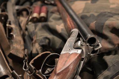 antique double-barreled shotgun, knife and ammunition belt