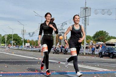 September 15, 2019 Minsk Belarus Two happy girls cross the finish line of the marathon