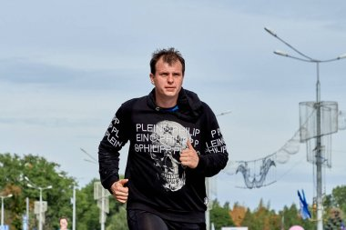 September 15, 2019 Minsk Belarus A marathon race in which a close-up of an athlete crossing the finish line on a city road