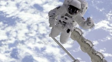 Astronaut moving in outer space