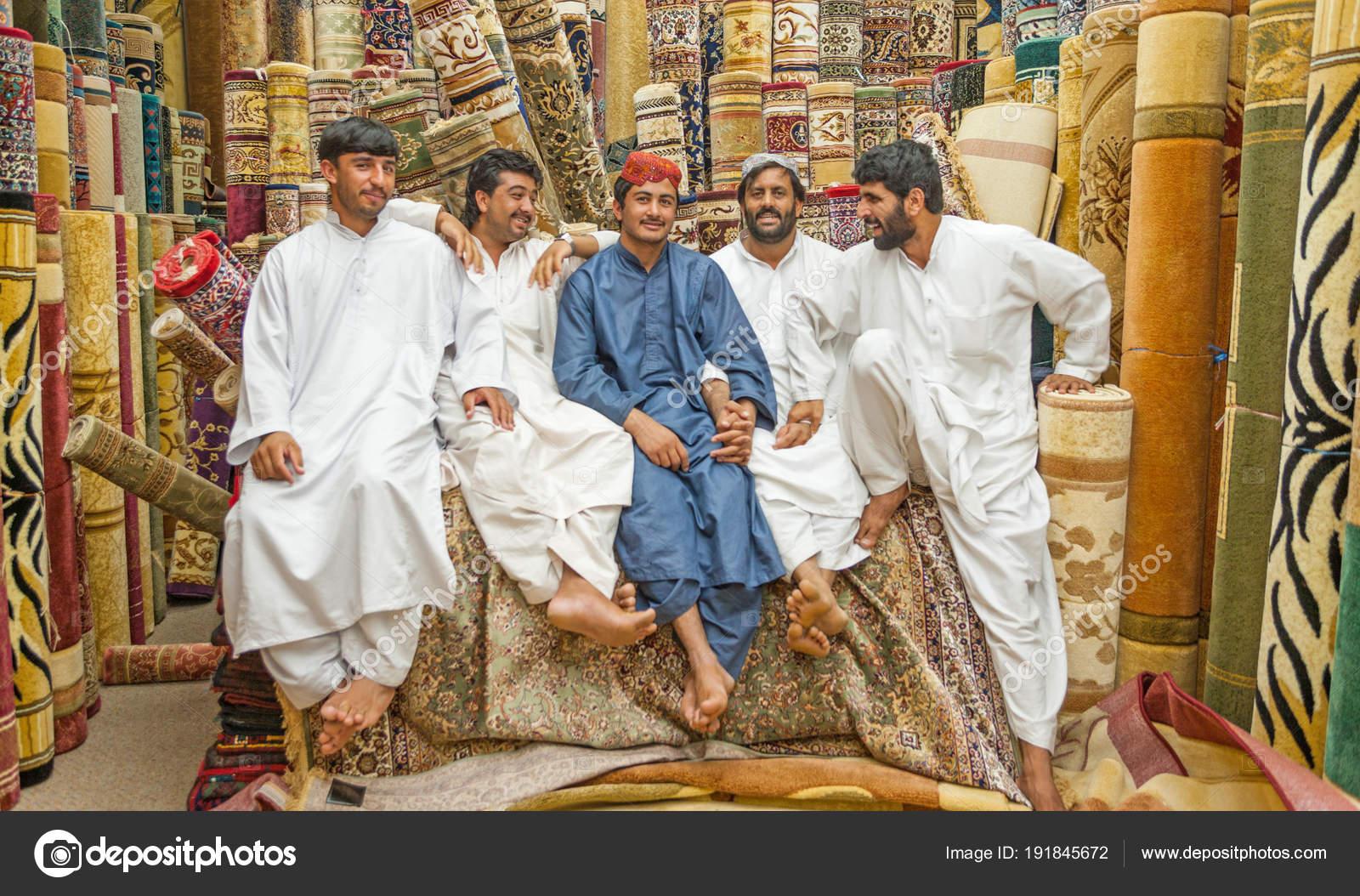 Men at the Carpet Souk in Abu Dhabi – Stock Editorial Photo