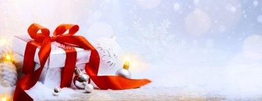art Christmas gift box and Christmas decoration on light backgro