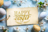Fotografie Happy Easter Background; Spring flowers and easter eggs