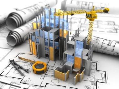 building construction over blueprints