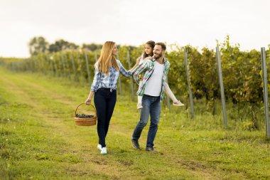 Happy family in vineyard