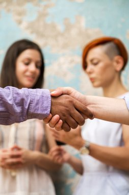 Business partners making handshake in office