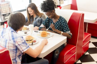 Friends eating in diner