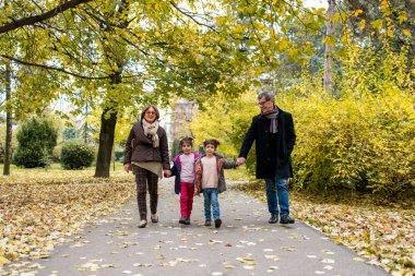 Grandparents with grandchildren in autumn park