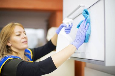 Cleaning woman in dental office