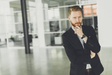 Redhair man posing in the office