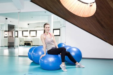 Sportive woman with a pilates ball