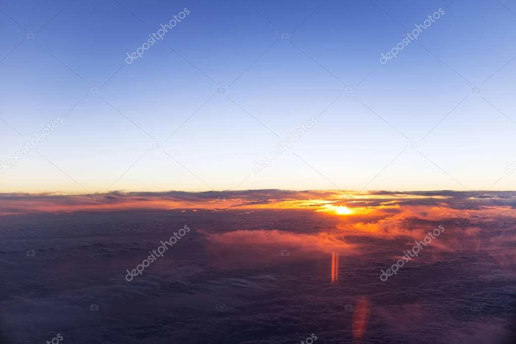 Sunset or sunrise from airplane