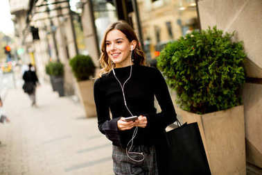 Young woman on the street with mobile phone