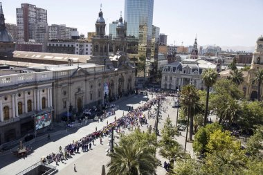 SANTIAGO DE CHILE, CHILE - JANUARY 16, 2018: Unidentified people on the street of Santiago de Chile during visit of Pope Francis. During his four day visit in Chile, Pope visited Santiago, Iquique and Temuco.