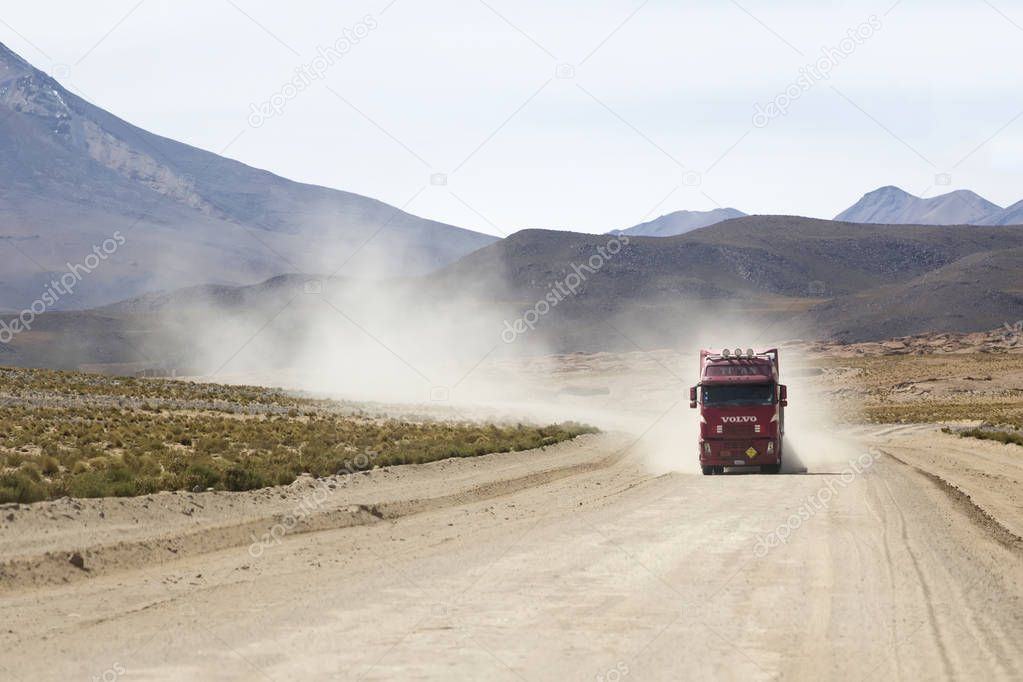 BOLIVIA - JANUARY 14, 2018: Truck on the unpaved road in Bolivia. At 2004 more than 92% of roads in Bolivia were unpaved.