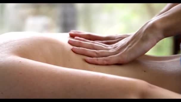 Beautiful blond woman enjoying a massage at the health spa