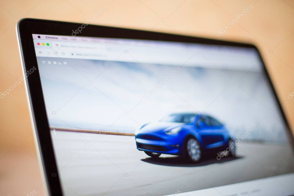 BELGRADE, SERBIA - MARCH 9, 2020: Tesla company web site on computer screen in Belgrade, Serbia. It is an American company that specializes in electric automotives founded at 2003. stock vector