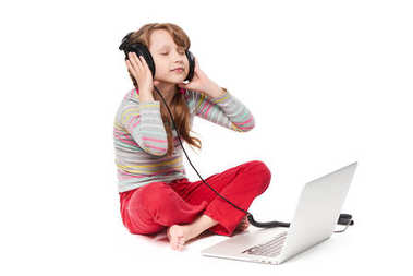 Girl sitting with laptop and headphones